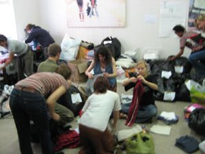 TAC volunteers sort clothes - May 25