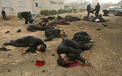 Bodies outside the Hamas police headquarters in Gaza City, following an Israeli air strike on 27 December.